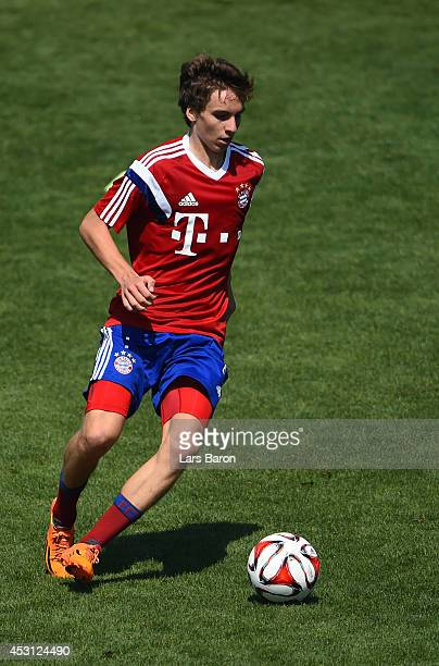 Gianluca Gaudino runs with the ball during a Bayern Muenchen training session at day five of the Audi Summer Tour USA 2014 at Portland University on...