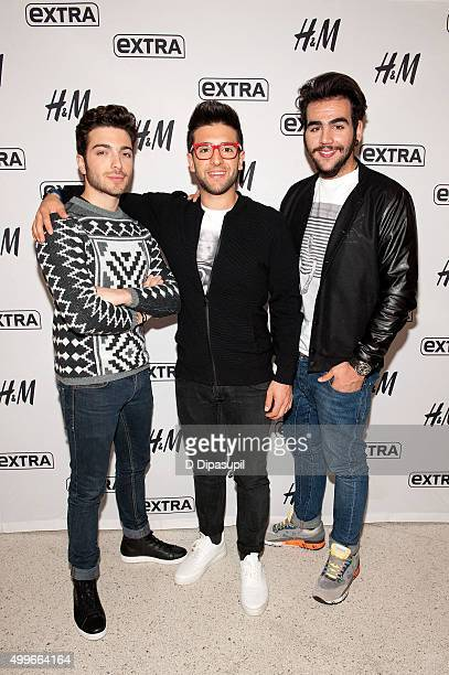 Gianluca Ginoble Ignazio Boschetto and Piero Barone of Il Volo visit 'Extra' at HM Times Square on December 2 2015 in New York City