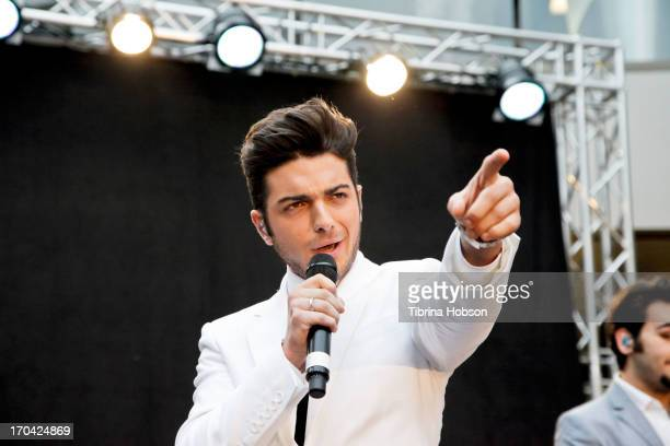 2 Gianluca Ginoble of Il Volo performs songs from their album 'We Are Love' at Barnes Noble 3rd Street Promenade on June 12 2013 in Santa Monica...