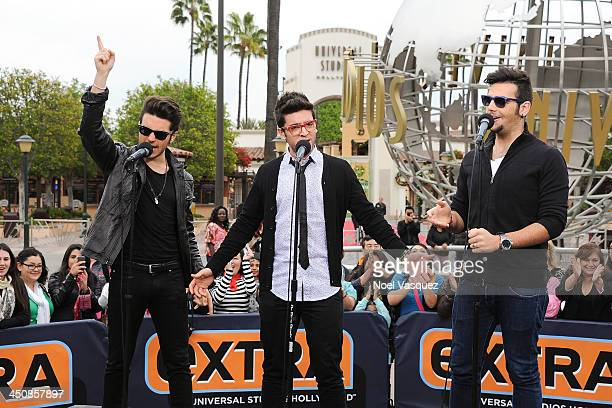 Gianluca Ginoble Piero Barone and Ignazio Boschetto of Il Volo perform at 'Extra' at Universal Studios Hollywood on November 20 2013 in Los Angeles...