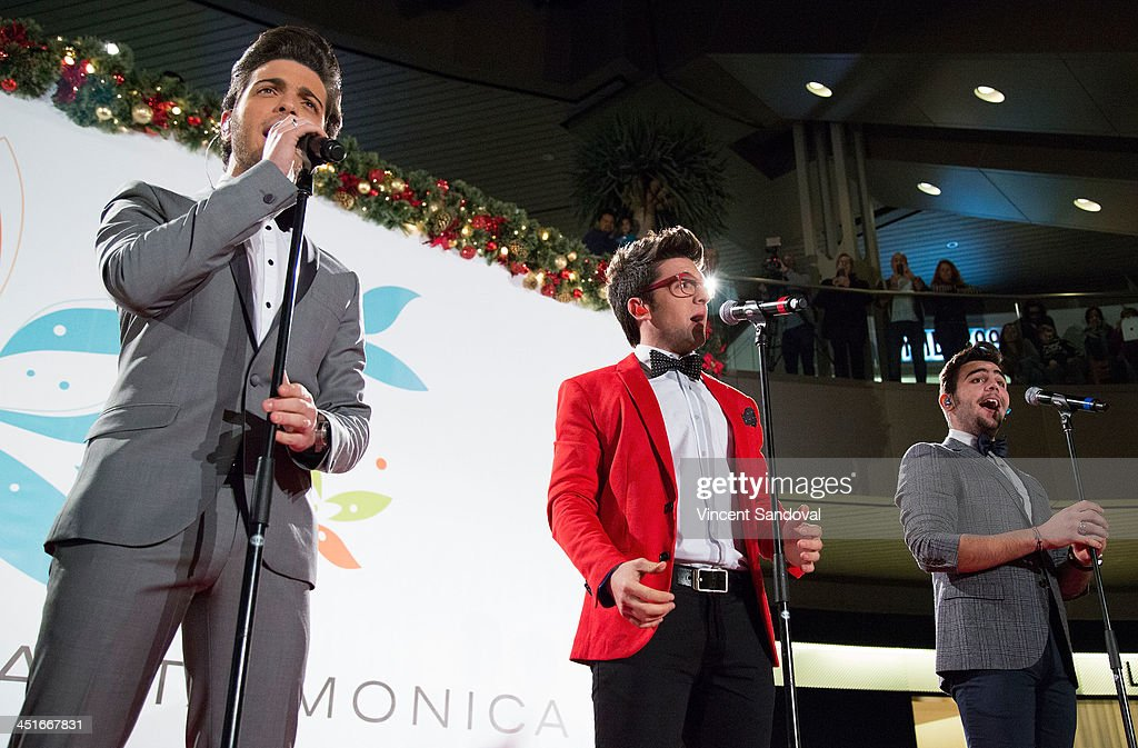 Gianluca Ginoble Piero Barone and Ignazio Boschetto of Il Volo perform during the HGTV Holiday House KickOff at Santa Monica Place with performance...