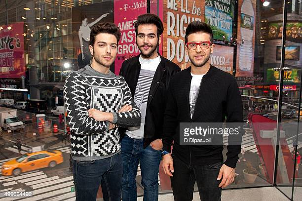 Gianluca Ginoble Piero Barone and Ignazio Boschetto of Il Volo visit 'Extra' at HM Times Square on December 2 2015 in New York City