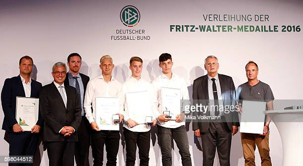GianLuca Itter of Wolfsburg Kai Havertz of Leverkusen and Arne Maier of Berlin are awarded in the U17 category with the FritzWalterMedal for their...