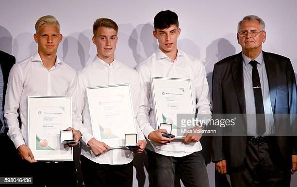 GianLuca Itter of Wolfsburg Kai Havertz of Leverkusen and Arne Maier of Berlin are awarded by DFB vice president Dr HansDieter Drewitz in the U17...