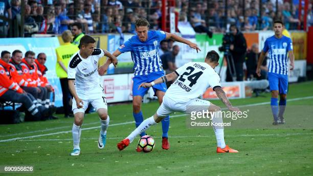 Gianluca Korte and Simon Tting of Mannheim challenge Patrick Posipal of Meppen during the Relegation Regionalliga Play Off second leg match at Hensch...