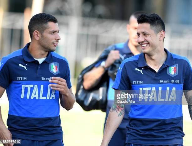 Gianluca Lapadula and Gianluca Caprari of Italy chat during the training session at Coverciano at Coverciano on May 29 2017 in Florence Italy