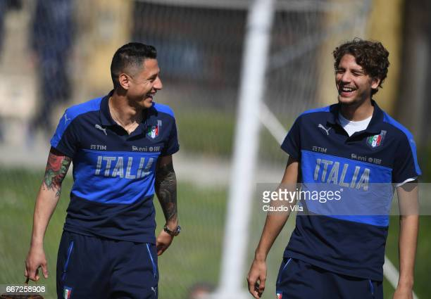 Gianluca Lapadula and Manuel Locatelli of Italy chat prior to the training session at the club's training ground at Coverciano on April 11 2017 in...