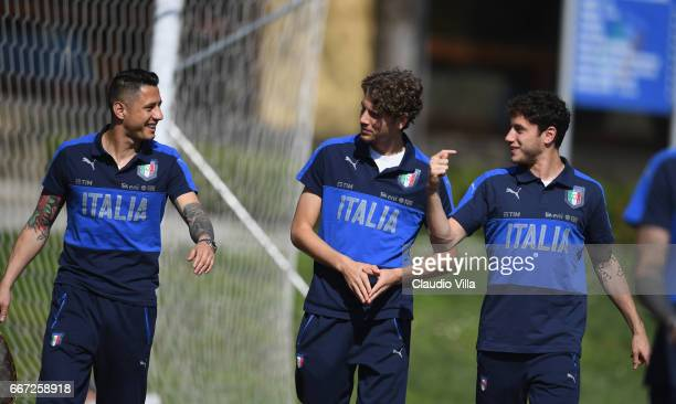 Gianluca Lapadula Manuel Locatelli and Davide Calabria of Italy chat prior to the training session at the club's training ground at Coverciano on...