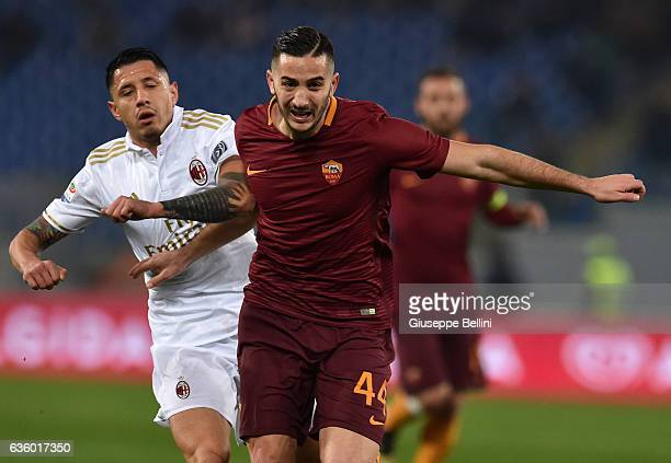Gianluca Lapadula of AC Milan and Kostas Manolas of AS Roma in action during the Serie A match between AS Roma and AC Milan at Stadio Olimpico on...
