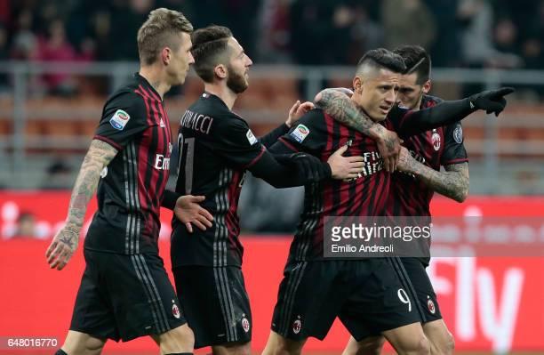 Gianluca Lapadula of AC Milan celebrates his goal with his teammates Jose Sosa and Andrea Bertolacci during the Serie A match between AC Milan and AC...
