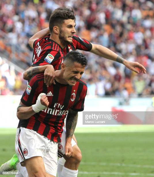 Gianluca Lapadula of AC Milan celebrates his goal with his teammates Patrick Cutrone during the Serie A match between AC Milan and Bologna FC at...