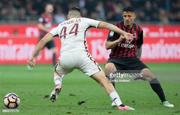 Gianluca Lapadula of AC Milan competes for the ball with Kostas Manolas of AS Roma during the Serie A match between AC Milan and AS Roma at Stadio...