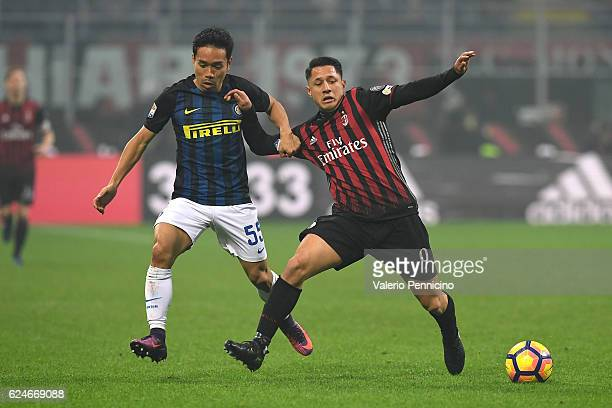 Gianluca Lapadula of AC Milan competes with Yuto Nagatomo of FC Internazionale during the Serie A match between AC Milan and FC Internazionale at...