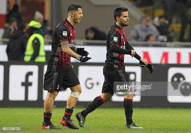 Gianluca Lapadula of AC Milan disputes with his teammate Suso at the end of the Serie A match between AC Milan and Cagliari Calcio at Stadio Giuseppe...