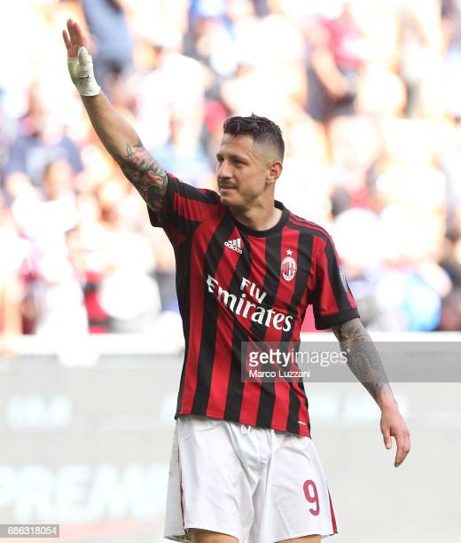 Gianluca Lapadula of AC Milan salutes the fans at the end of the Serie A match between AC Milan and Bologna FC at Stadio Giuseppe Meazza on May 21...