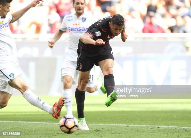 Gianluca Lapadula of AC Milan scores his goal during the Serie A match between AC Milan and Empoli FC at Stadio Giuseppe Meazza on April 23 2017 in...