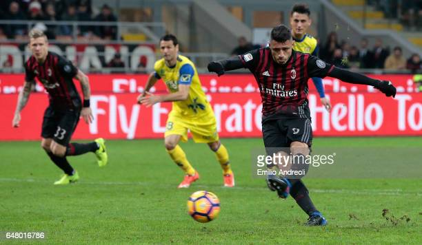Gianluca Lapadula of AC Milan scores on a penalty kick during the Serie A match between AC Milan and AC ChievoVerona at Stadio Giuseppe Meazza on...
