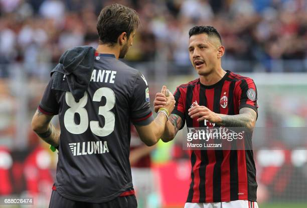 Gianluca Lapadula of AC Milan shakes hands with Antonio Mirante of Bologna FC at the end of the Serie A match between AC Milan and Bologna FC at...