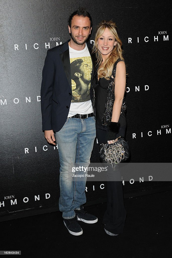 Gianluca Pazzini and Silvia Slitti attend the John Richmond fashion show as part of Milan Fashion Week Womenswear Fall/Winter 2013/14 on February 25, 2014 in Milan, Italy.