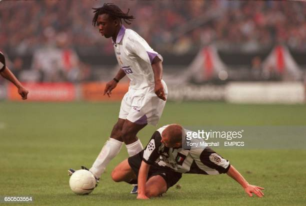 Gianluca Pessotto Juventus tries to tackle Real Madrid's Clarence Seedorf