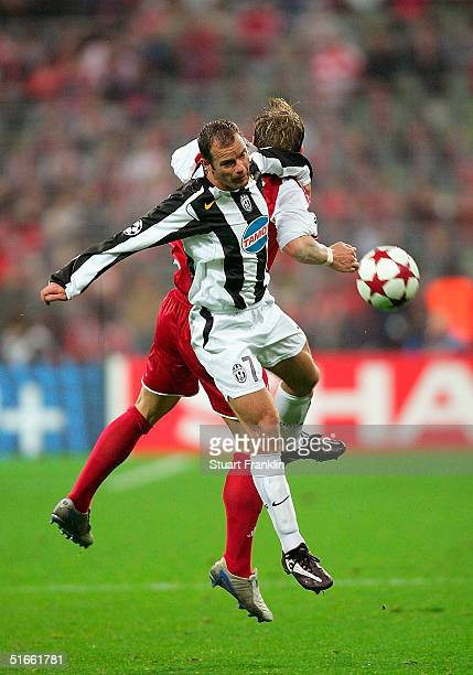 Gianluca Pessotto of Juventus in action against Torsten Frings of Bayern Munich during The UEFA Champions League group C match between FC Bayern...