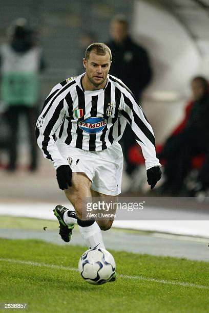 Gianluca Pessotto of Juventus runs with the ball during the UEFA Champions League Group D match between Juventus and Olympiakos held on December 10...