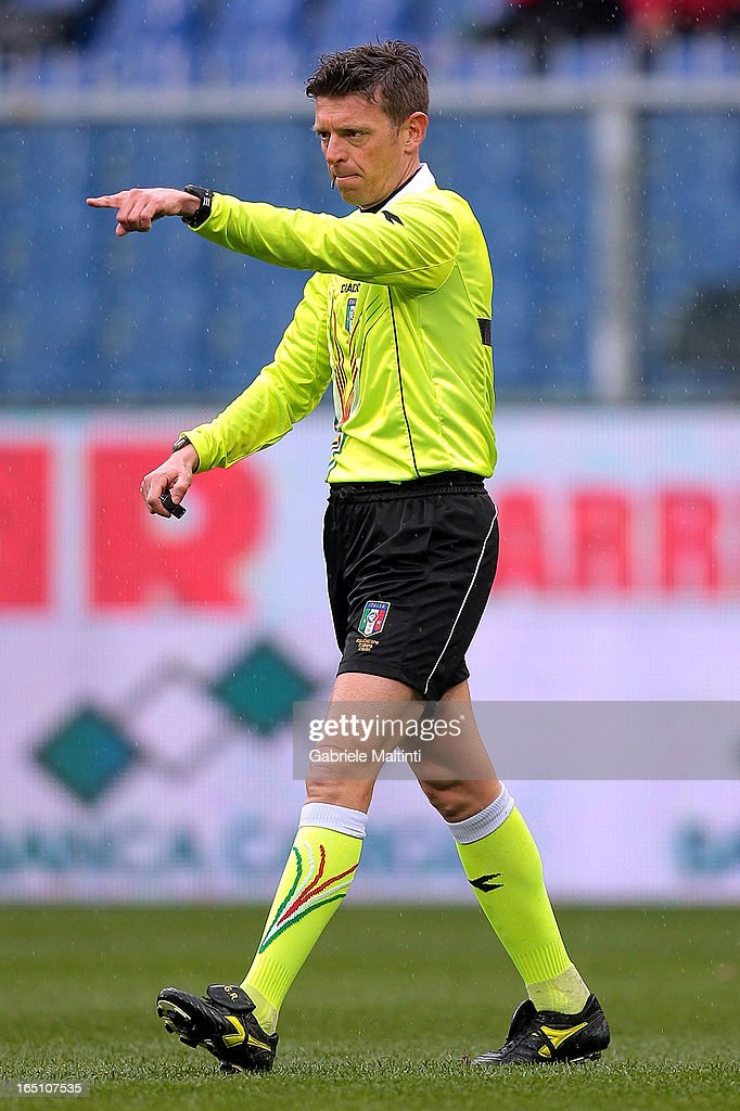 Gianluca Rocchi referee gestures during the Serie A match between Genoa CFC and AC Siena at Stadio Luigi Ferraris on March 30, 2013 in Genoa, Italy.