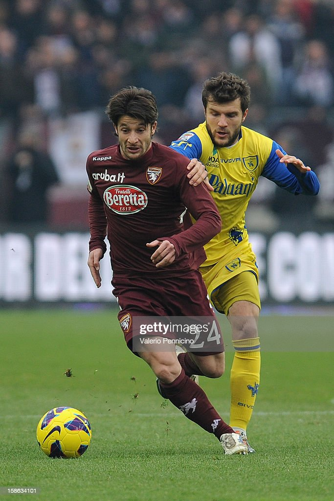 Gianluca Sansone (L) of Torino FC is challenged by <a gi-track='captionPersonalityLinkClicked' href=/galleries/search?phrase=Perparim+Hetemaj&family=editorial&specificpeople=4143278 ng-click='$event.stopPropagation()'>Perparim Hetemaj</a> of AC Chievo Verona during the Serie A match between Torino FC and AC Chievo Verona at Stadio Olimpico di Torino on December 22, 2012 in Turin, Italy.