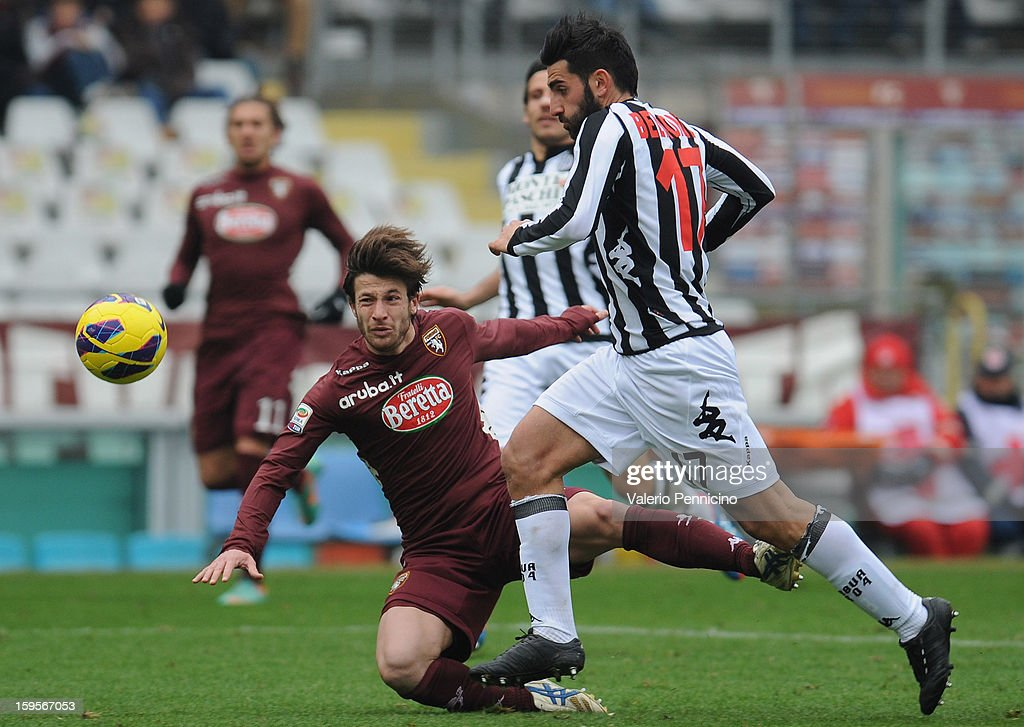 Gianluca Sansone (L) of Torino FC is tackled by Nicola Belmonte of AC Siena during the Serie A match between Torino FC and AC Siena at Stadio Olimpico di Torino on January 13, 2013 in Turin, Italy.