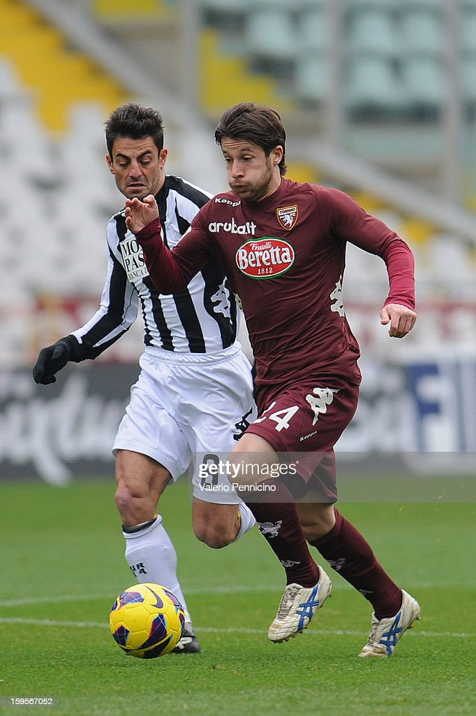 Gianluca Sansone (R) of Torino FC runs of Simone Vergassola of AC Siena during the Serie A match between Torino FC and AC Siena at Stadio Olimpico di Torino on January 13, 2013 in Turin, Italy.