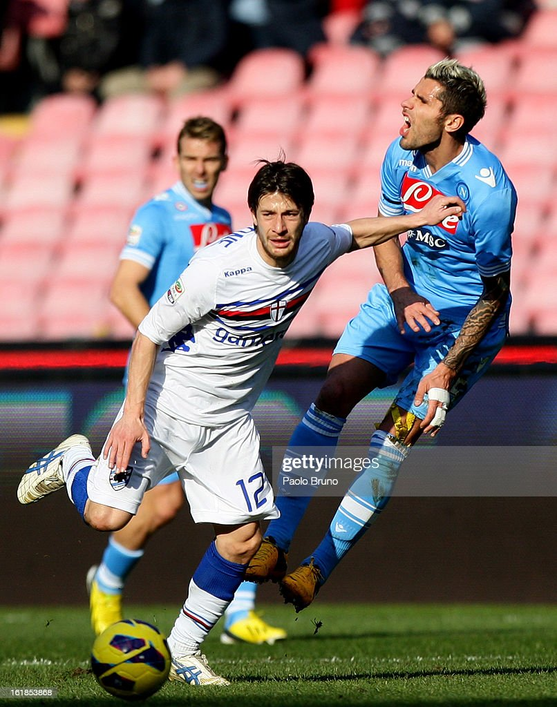 Gianluca Sansone (L) of UC Sampdoria competes for the ball with <a gi-track='captionPersonalityLinkClicked' href=/galleries/search?phrase=Valon+Behrami&family=editorial&specificpeople=453450 ng-click='$event.stopPropagation()'>Valon Behrami</a> of SSC Napoli during the Serie A match between SSC Napoli and UC Sampdoria at Stadio San Paolo on February 17, 2013 in Naples, Italy.