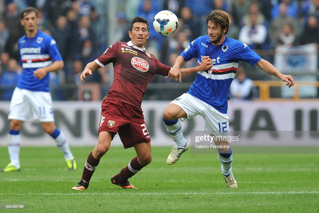 Gianluca Sansone (R) of UC Sampdoria is challenged by Giuseppe Vives of Torino FC during the Serie A match between UC Sampdoria and Torino FC at Stadio Luigi Ferraris on October 6, 2013 in Genoa, Italy.