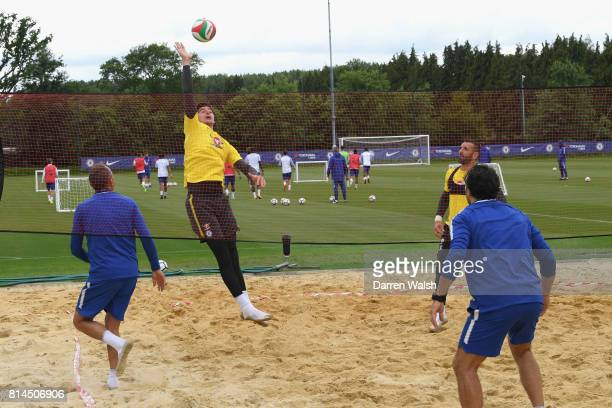 Gianluca Spinelli Thibaut Courtois Eduardo and Henrique Hilario of Chelsea playing volleyball during a training session at Chelsea Training Ground on...