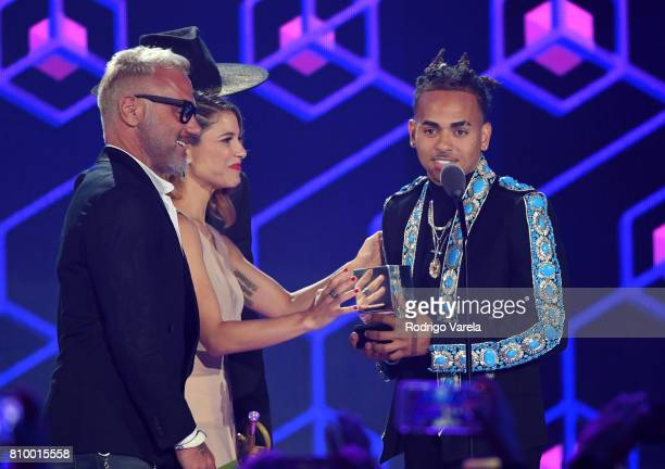 Gianluca Vacchi and Ozuna on stage during Univision's 'Premios Juventud' 2017 Celebrates The Hottest Musical Artists And Young Latinos ChangeMakers...