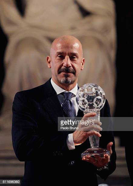 Gianluca Vialli poses showing the award during the Italian Football Federation Hall of Fame Award ceremony at Palazzo Vecchio on February 22 2016 in...
