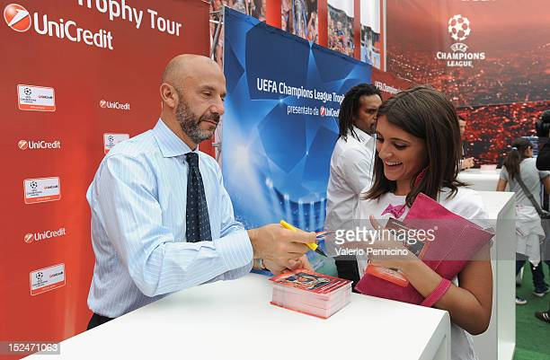 Gianluca Vialli signs photos for his fan during the UEFA Champions League Trophy Tour 2012/13 on September 21 2012 in Turin Italy
