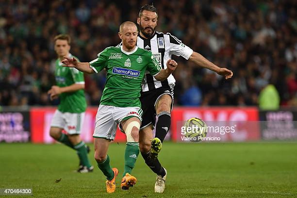 Gianluca Zambrotta is challenged during the UEFA Match Against Poverty at Stade GeoffroyGuichard on April 20 2015 in SaintEtienne France