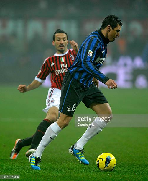 Gianluca Zambrotta of AC Milan and Lucio of FC Inter Milan compete for the ball during the Serie A match between AC Milan and FC Internazionale...