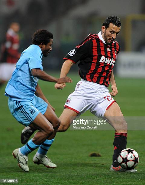 Gianluca Zambrotta of AC Milan battles for the ball against Bakari Kone of Olympique de Marseille during the UEFA Champions League Group C match...
