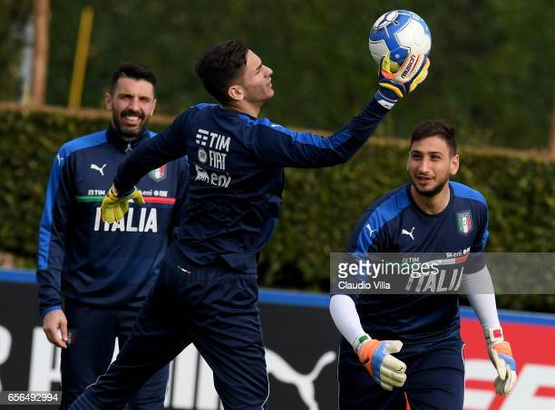 Gianluigi Buffon Alex Meret and Gianluigi Donnarumma of Italy in action during the training session at the club's training ground at Coverciano on...