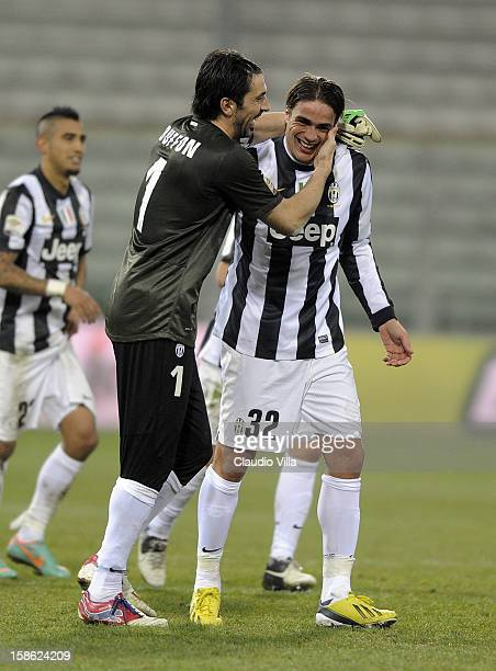 Gianluigi Buffon and Alessandro Matri of FC Juventus and celebrate victory after the Serie A match between Cagliari Calcio and FC Juventus at Stadio...