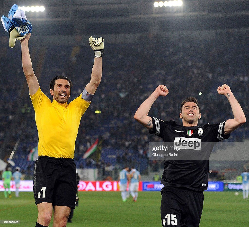 <a gi-track='captionPersonalityLinkClicked' href=/galleries/search?phrase=Gianluigi+Buffon&family=editorial&specificpeople=208860 ng-click='$event.stopPropagation()'>Gianluigi Buffon</a> and <a gi-track='captionPersonalityLinkClicked' href=/galleries/search?phrase=Andrea+Barzagli&family=editorial&specificpeople=465353 ng-click='$event.stopPropagation()'>Andrea Barzagli</a> of Juventus celebrate their victory after the Serie A match between S.S. Lazio and Juventus at Stadio Olimpico on April 15, 2013 in Rome, Italy.