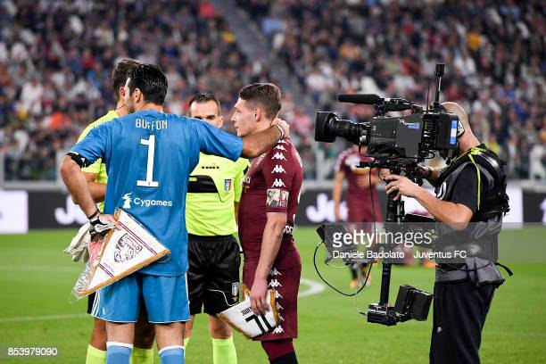 Gianluigi Buffon and Andrea Belotti during the Serie A match between Juventus and Torino FC on September 23 2017 in Turin Italy