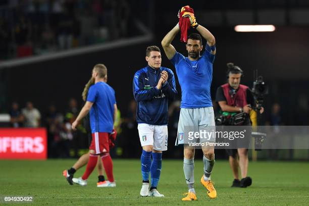 Gianluigi Buffon and Andrea Belotti of Italy applaud the fans following their team's 050 victory during the FIFA 2018 World Cup Qualifier between...