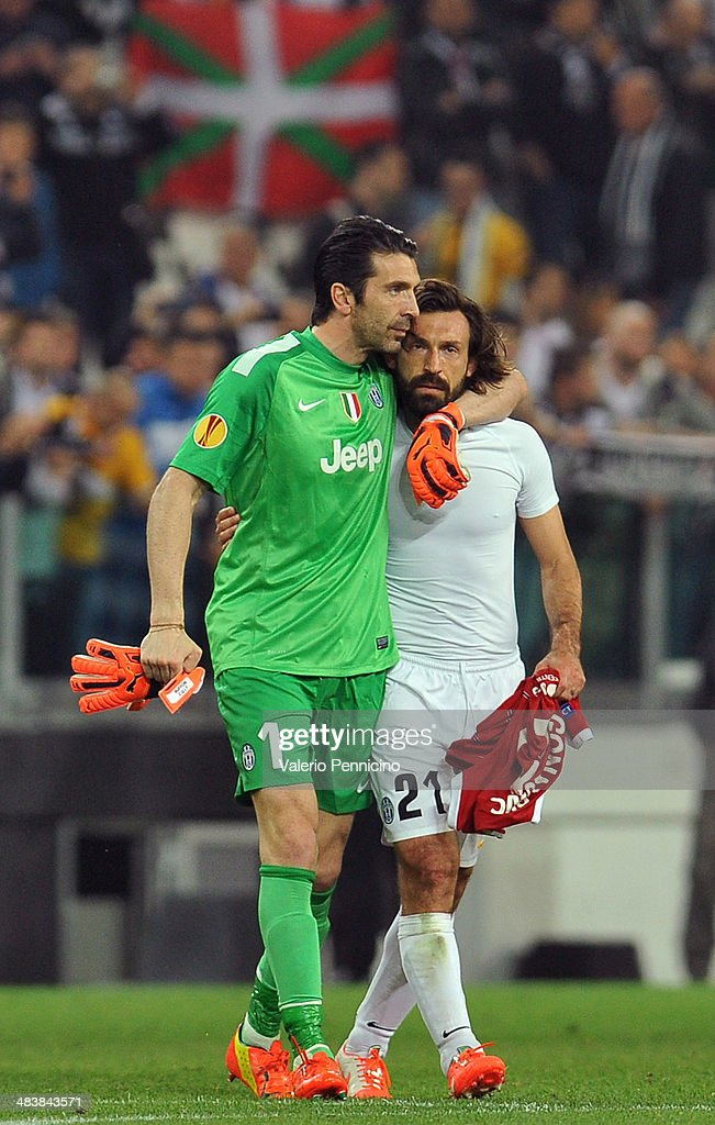 Gianluigi Buffon (L) and Andrea Pirlo of 2Juventus celebrate victory at the end of the UEFA Europa League quarter final match between Juventus and Olympique Lyonnais at Juventus Arena on April 10, 2014 in Turin, Italy.