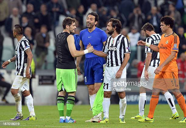 Gianluigi Buffon and Andrea Pirlo of Juventus and Iker Casillas of Real Madrid after the UEFA Champions League Group B match between Juventus and...
