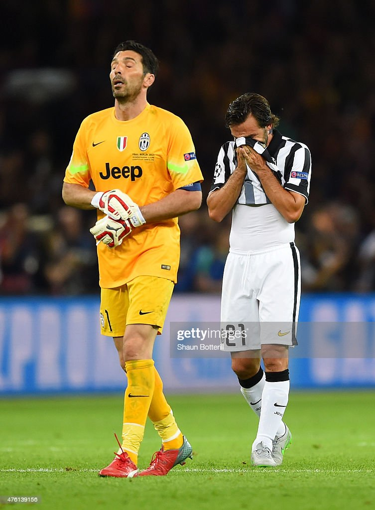 Gianluigi Buffon and Andrea Pirlo of Juventus look dejected after the UEFA Champions League Final between Juventus and FC Barcelona at Olympiastadion...