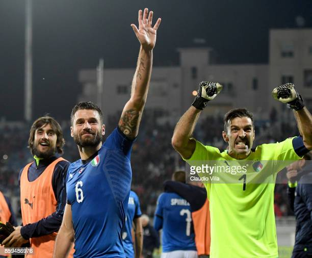 Gianluigi Buffon and Antonio Candreva celebrates win after the FIFA 2018 World Cup Qualifier between Albania and Italy at Loro Borici Stadium on...