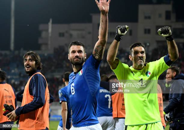 Gianluigi Buffon and Antonio Candreva of Italy celebrate at the end of the FIFA 2018 World Cup Qualifier between Albania and Italy at Loro Borici...
