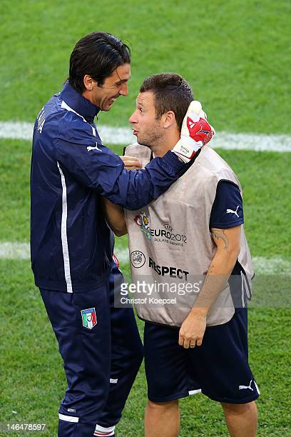 Gianluigi Buffon and Antonio Cassano of Italy make nonsense during a UEFA EURO 2012 training session at the Municipal Stadium on June 17 2012 in...